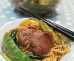 Stir fried egg noodles with duck breast and vegetables